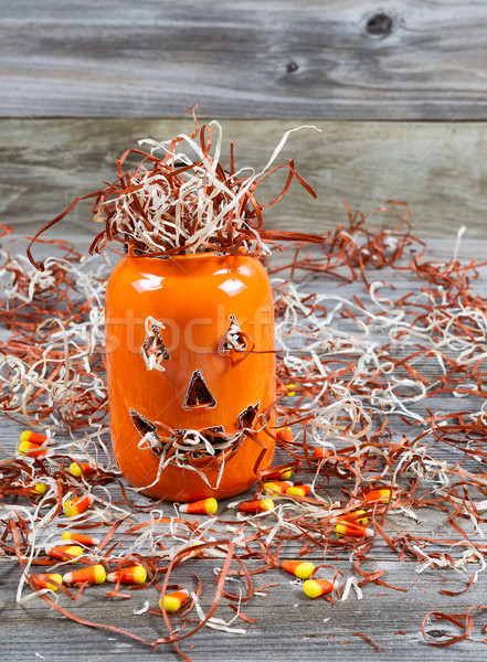 Scary large orange pumpkin ceramic jar on rustic wood   Stock photo © tab62