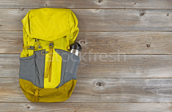 Weather proof backpack for hiking on rustic wooden boards  Stock photo © tab62