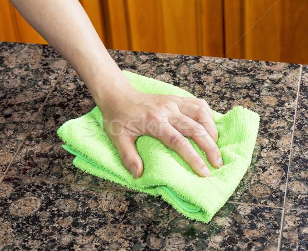 Wiping down Kitchen Stone Countertop  Stock photo © tab62
