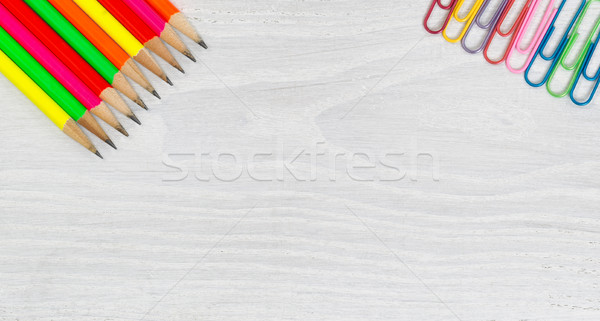 Bright colorful pencils and paper clips on white wooden desktop Stock photo © tab62