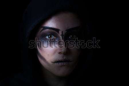 Girl in hoodie with scary face makeup on black background Stock photo © tab62