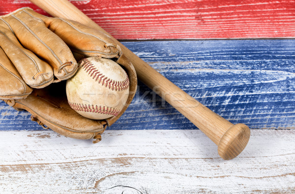 Old worn baseball equipment on faded boards painted in American  Stock photo © tab62