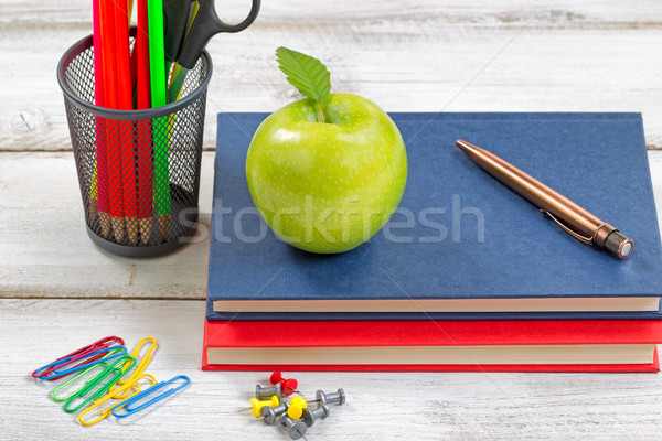 School supplies with textbooks on white desktop  Stock photo © tab62