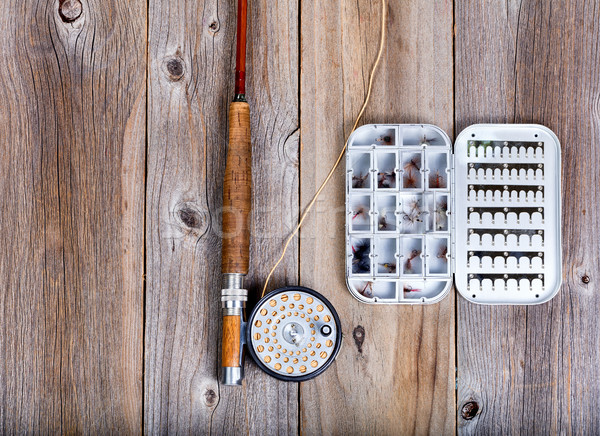 Vintage fishing fly equipment and lure container on rustic woode Stock photo © tab62