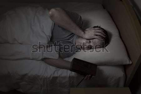 Mature man restless in bed while trying  to sleep  Stock photo © tab62