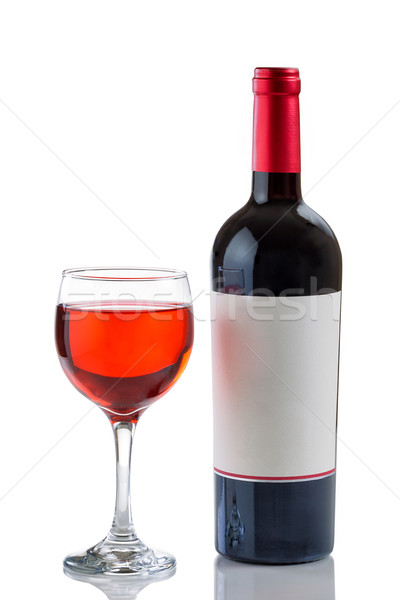 Red Wine in Glass next to full bottle on white background  Stock photo © tab62
