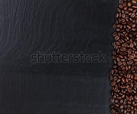 Roasted coffee beans on natural dark slate stone Stock photo © tab62