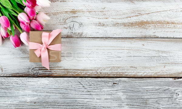 Pink springtime tulips and gift box on white rustic wooden board Stock photo © tab62