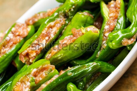 Uncooked Fresh Stuffed Green Peppers in bowl ready for cooking  Stock photo © tab62