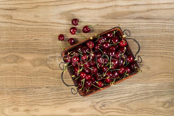 Fresh Black Cherries in basket place on Rustic Wood Stock photo © tab62