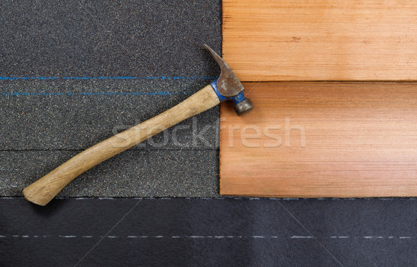Stock photo: Used roofing hammer with new shingles of composite and cedar woo