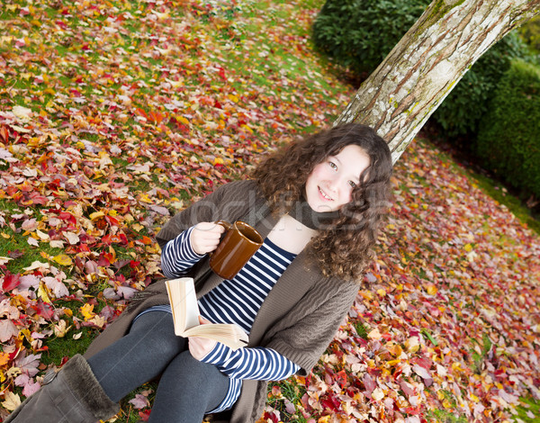 Teen Girl Relaxing Outdoors during the Autumn Season  Stock photo © tab62