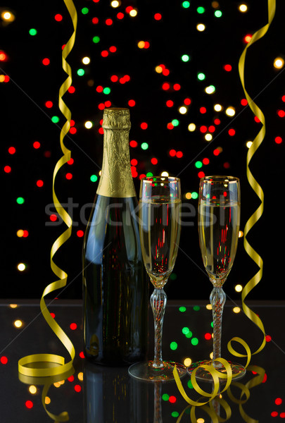 Two tall elegant glasses filled with Golden Champagne to bring i Stock photo © tab62