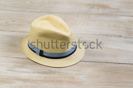 Straw Hat with Bird Feather on Faded Wood  Stock photo © tab62