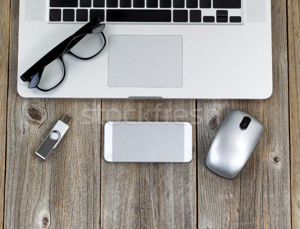 Laptop számítógép olvasószemüveg rusztikus iroda fából készült asztali Stock fotó © tab62