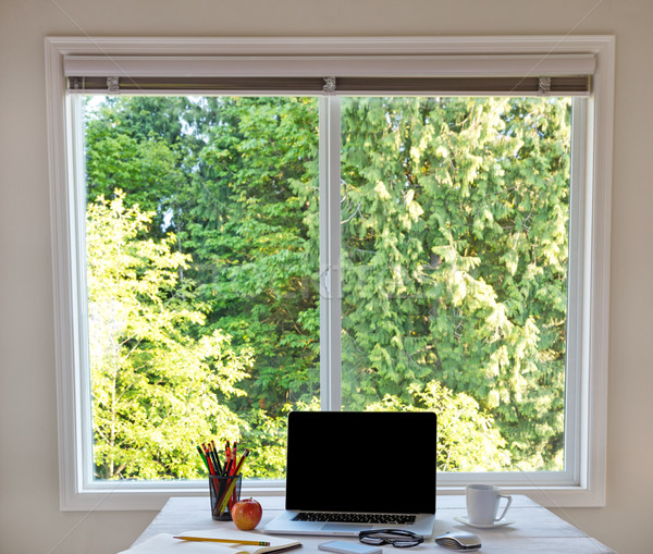 Clean desktop with bright daylight window in background  Stock photo © tab62