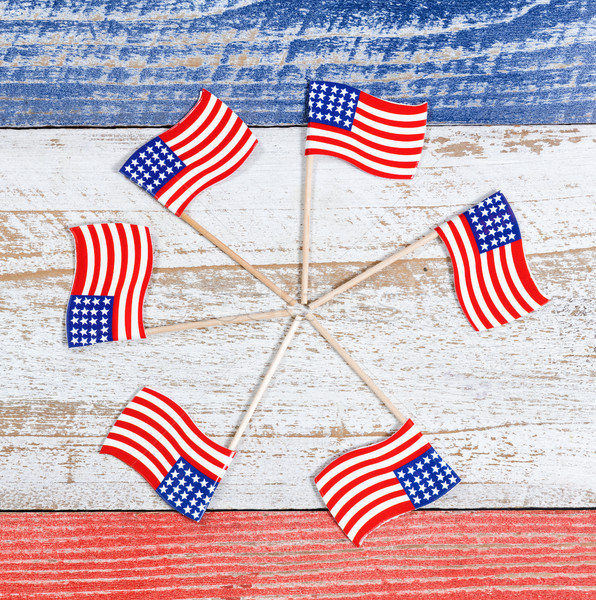 Small USA flags in pinwheel formation on rustic boards with nati Stock photo © tab62