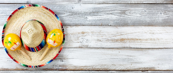 Flat lay view of traditional Cinco De Mayo objects on white weat Stock photo © tab62