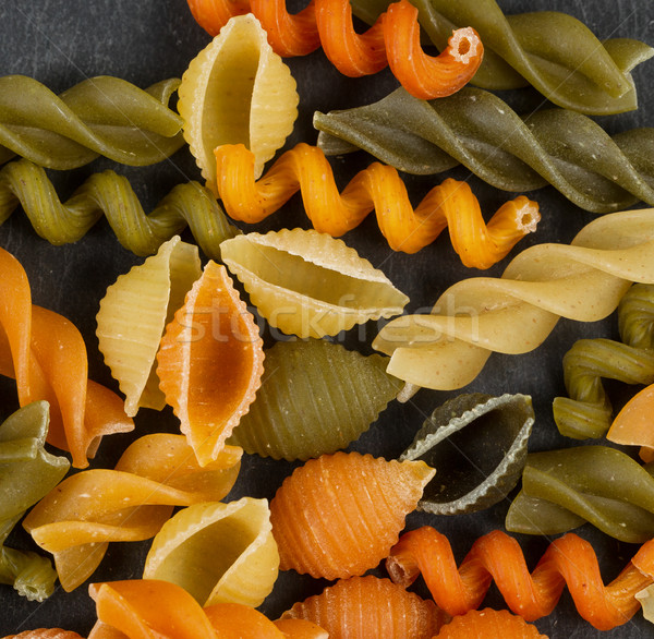Colorful raw pasta on natural black slate background  Stock photo © tab62