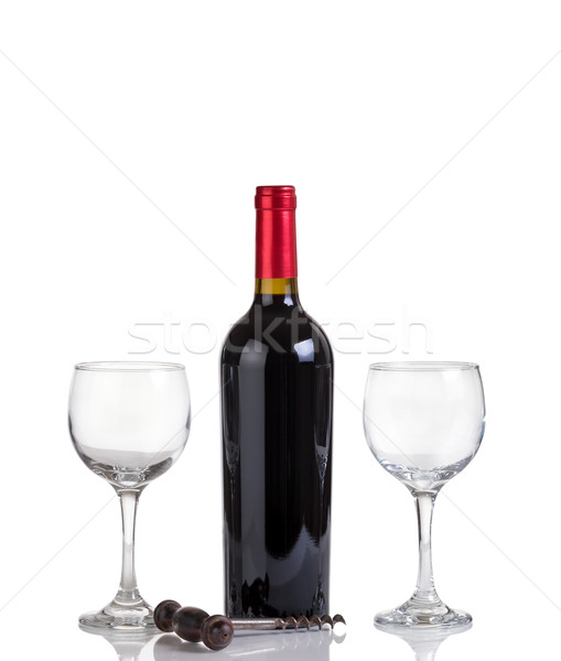 Unopened bottle of red wine and glasses isolated on white backgr Stock photo © tab62