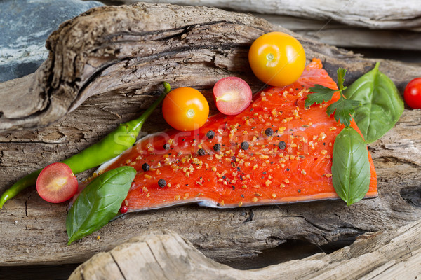 Wild Salmon Fillet placed inside of diftwood  Stock photo © tab62