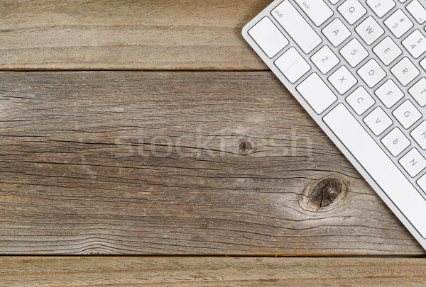 Partial computer keyboard on rustic wooden boards Stock photo © tab62