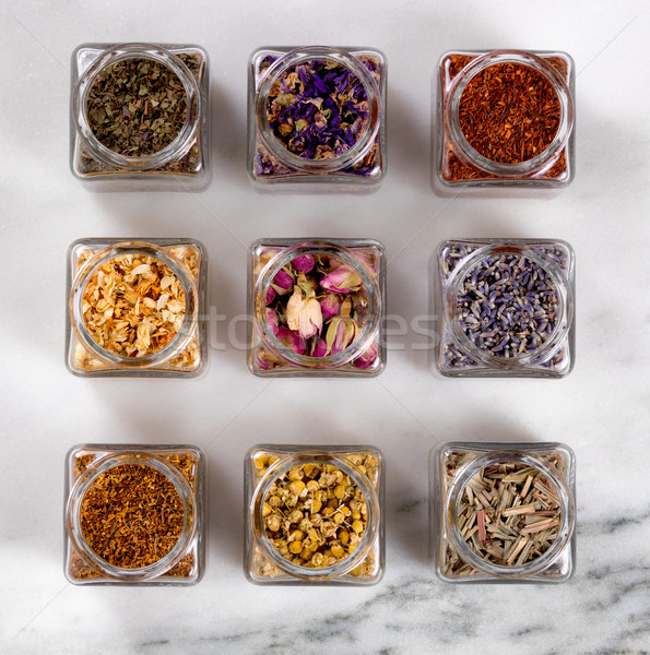 Spices and herbs in small glass jars on marble stone background  Stock photo © tab62