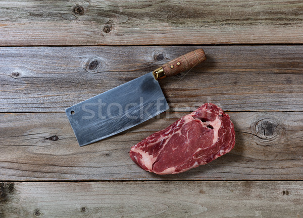 Prime Beef Steak with Butcher Knife on rustic wood  Stock photo © tab62