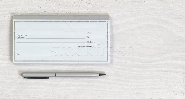 Blank checkbook and silver pen on white desktop Stock photo © tab62