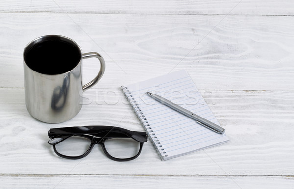 Fresh coffee with reading glasses and writing materials  Stock photo © tab62