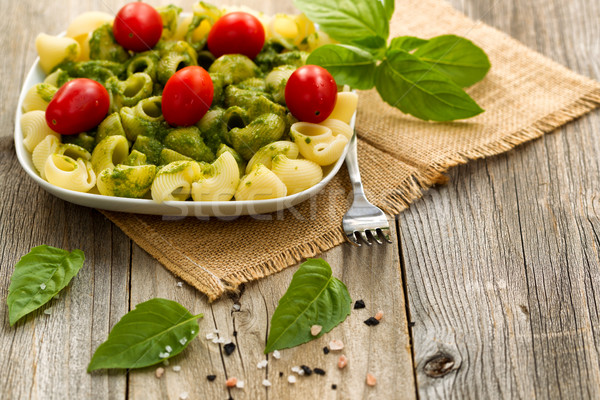Traditional basil pesto dish with cherry tomatoes on rustic wood Stock photo © tab62
