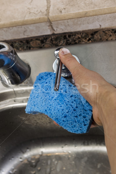 Soap Dispenser in Kitchen Sink being used  Stock photo © tab62