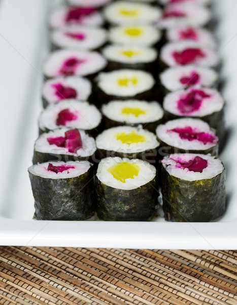Stock photo: Long Plate filled with Pickled Hand Rolled Sushi