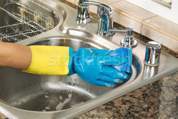 Cleaning inside of kitchen sink with soapy water and sponge  Stock photo © tab62