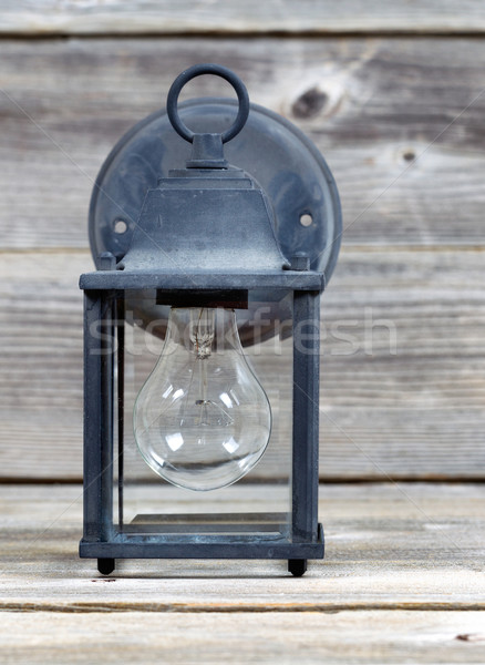 Vintage Outdoor Light on Weathered Wood Stock photo © tab62