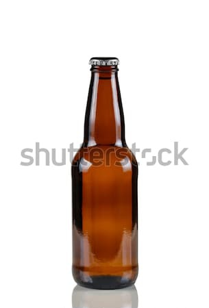 Unopened beer bottle on white with reflection  Stock photo © tab62