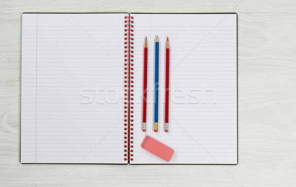 Stock photo: Blank notepad with pencils and eraser on desktop