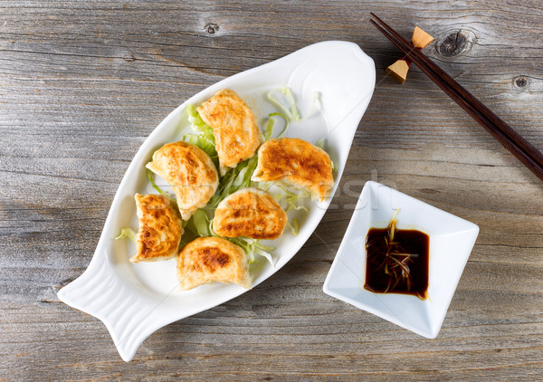 Chinese fried dumplings dish with dipping sauce ready to eat Stock photo © tab62