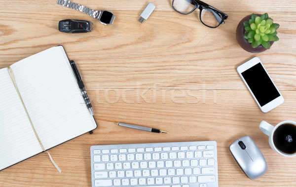Overhead view of red oak desktop with wireless technology in cir Stock photo © tab62