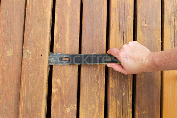 Removing old wooden boards with Pry Bar  Stock photo © tab62