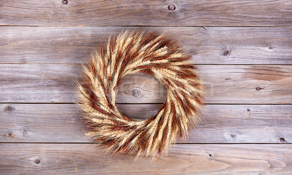 Dried wheat stalk wreath on rustic wooden boards Stock photo © tab62