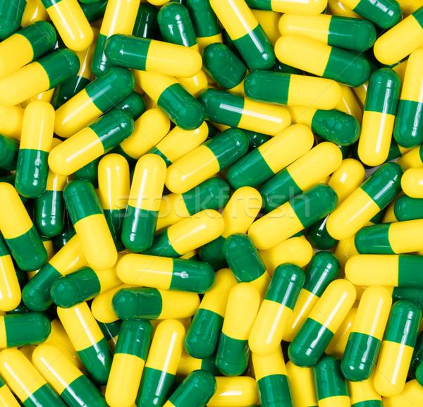 Gyógyszer kapszulák zöld citromsárga színek keret Stock fotó © tab62