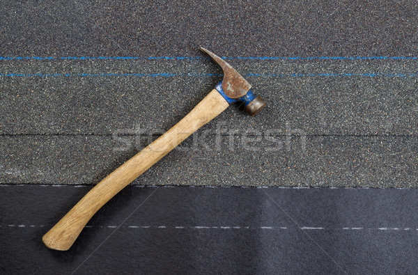 Used roofing hammer with new composite shingles on felt paper   Stock photo © tab62
