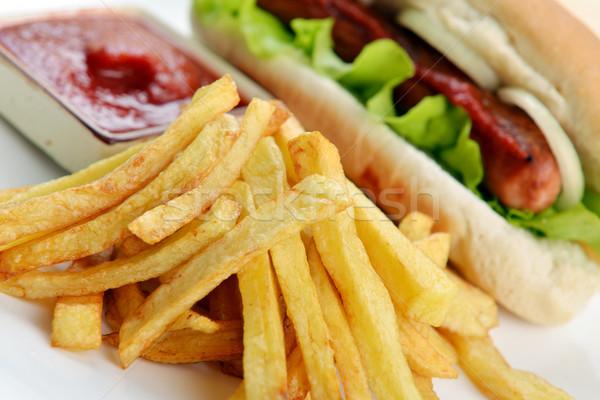 Appetitoso hot dog gustoso patatine bianco piatto Foto d'archivio © taden