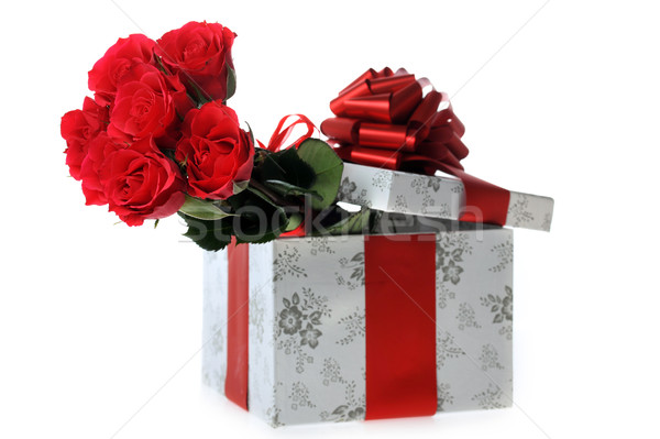 beautiful red roses and present Stock photo © taden