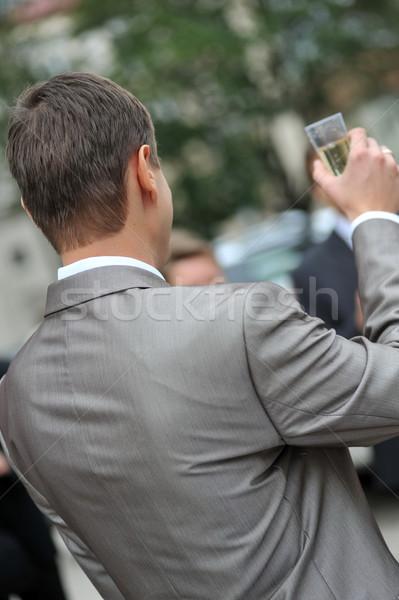 Vőlegény pezsgő szürke kabát üzlet virág Stock fotó © taden