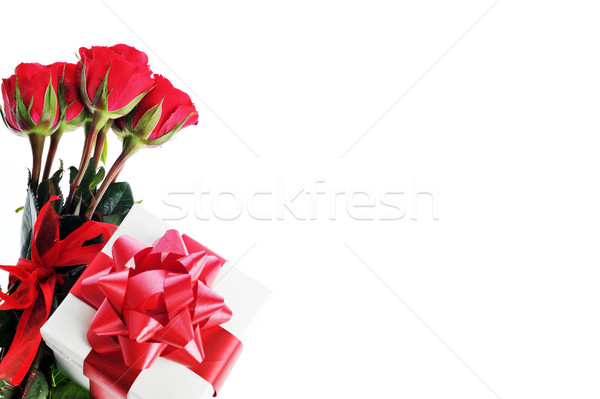 red roses and present with ribbon Stock photo © taden