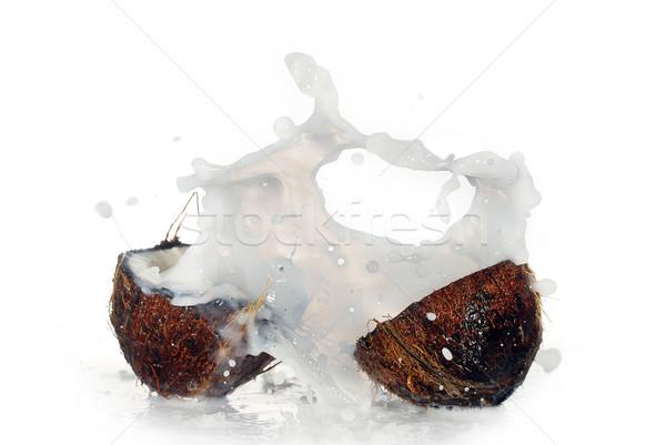 Agrietado coco grande Splash aislado agua Foto stock © taden
