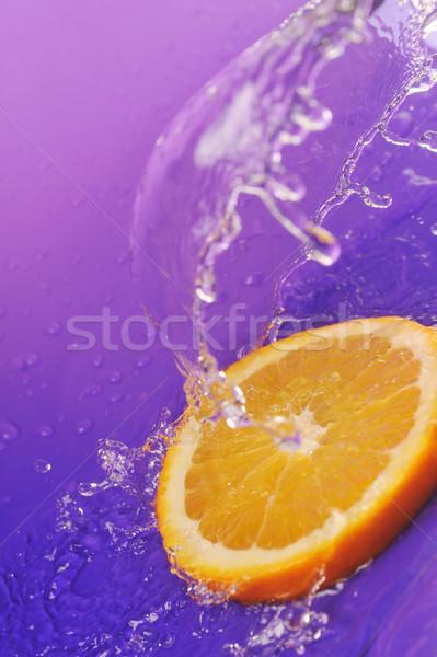 Sulu turuncu sıçraması parlak mor gıda Stok fotoğraf © taden