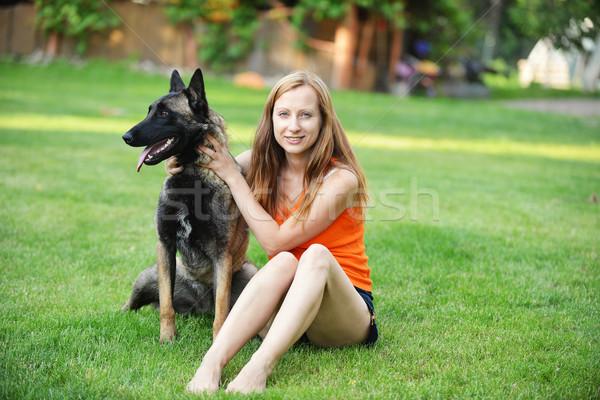 Donna cane giocare erba amore bellezza Foto d'archivio © taden